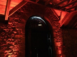 The Byre's main doorway. Although the wooden doors are closed on it, there are two large glass doors that spill natural light into the room.
