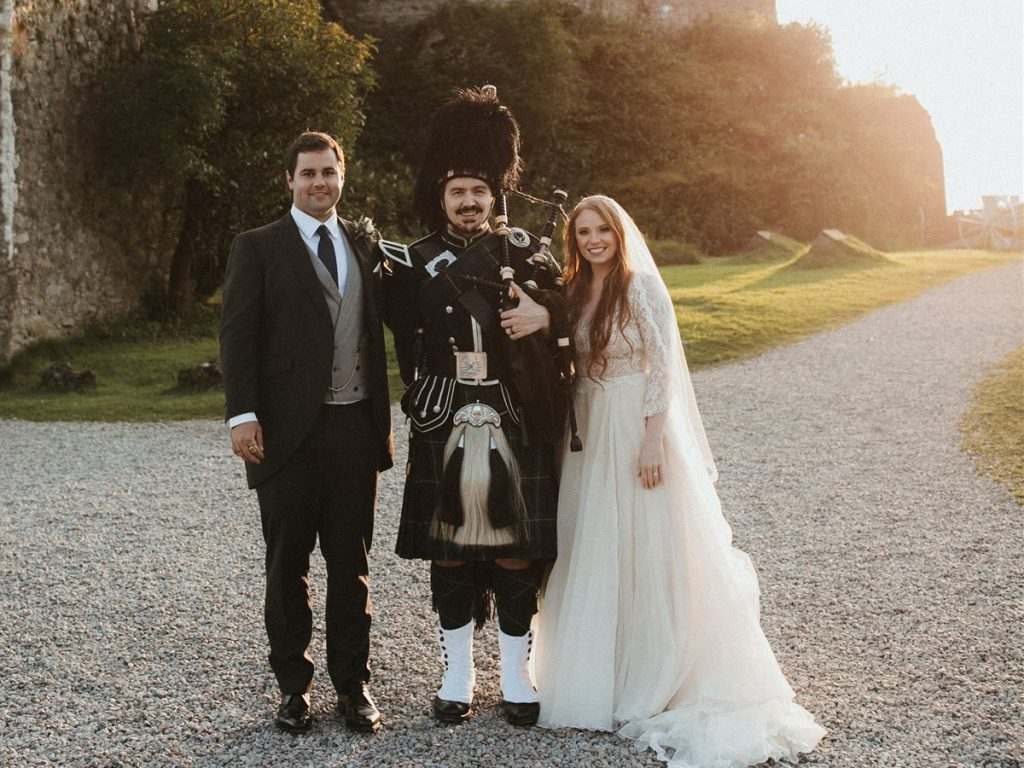 Rich at Eilean Donan Castle with bride and groom. Image courtesy of James Frost Photography.